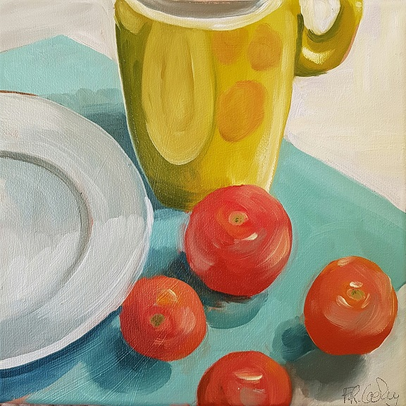 Mug and four tomatoes